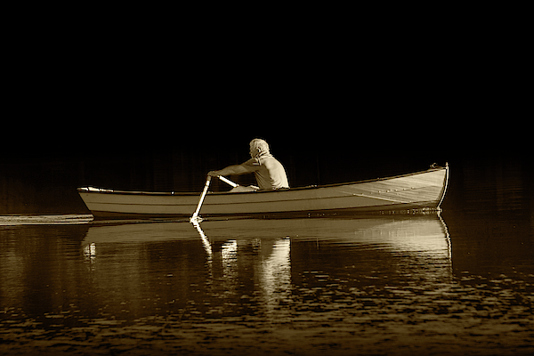Man rowing on Stoney Lake at Sunrise in Sepia Tone by Randall Nyhof